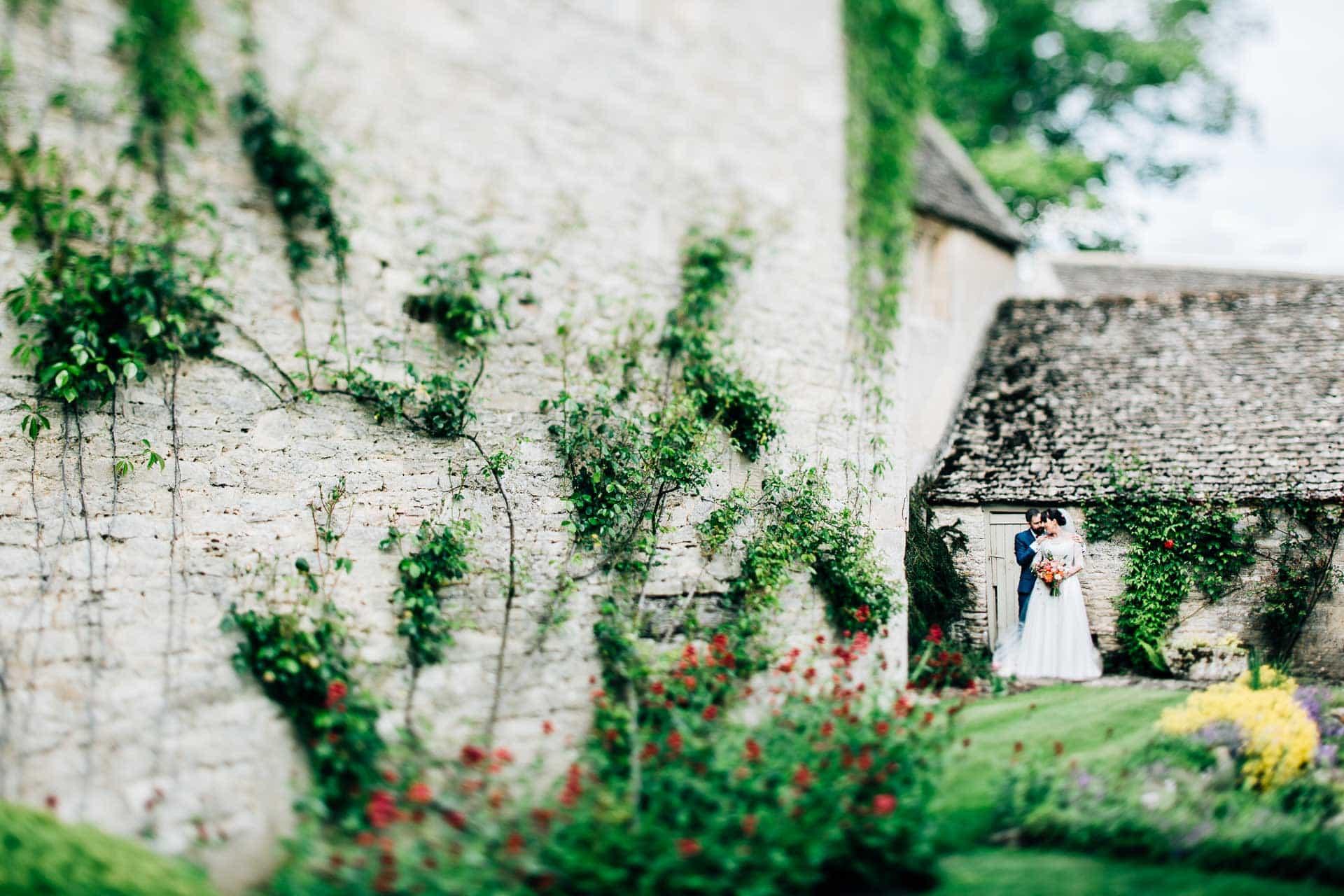 Caswell House Wedding Photography - couple by farm house