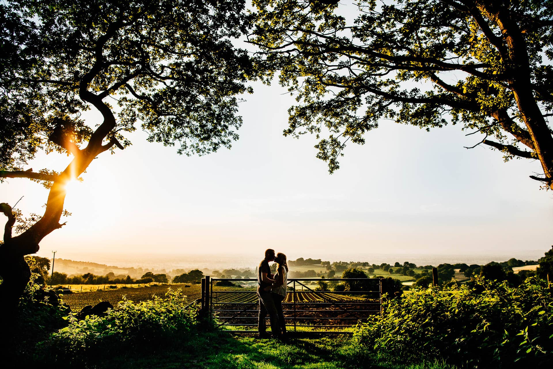 Cheshire Pre Wedding Photography - couple in gateway with hills in background