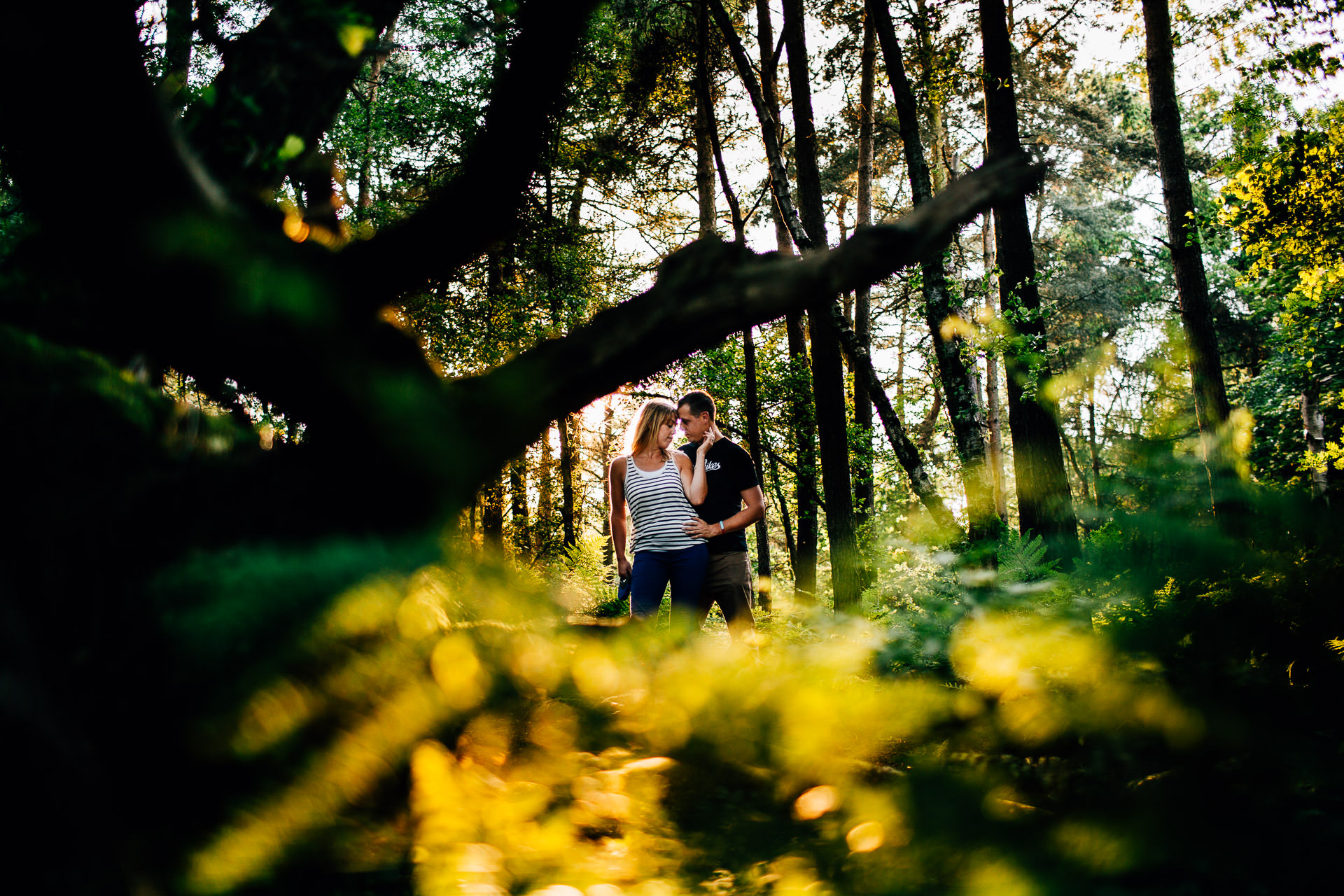 Cheshire Pre Wedding Photography - couple in the trees hand around neck