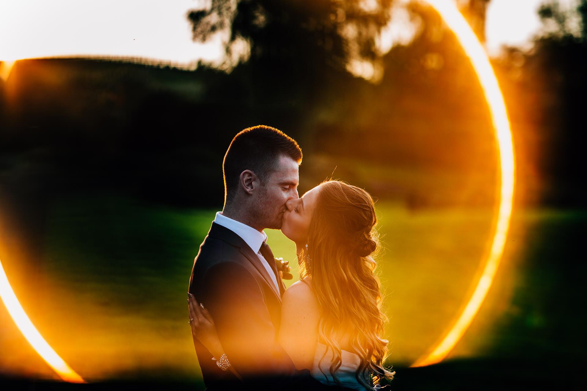 Weston Hall Wedding Photography - sun flare with couple
