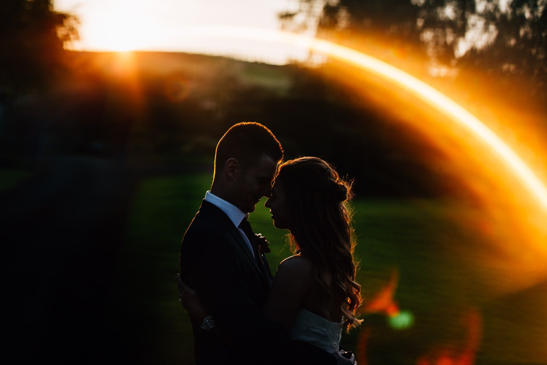 Weston Hall Wedding Photography - couple in sun flare