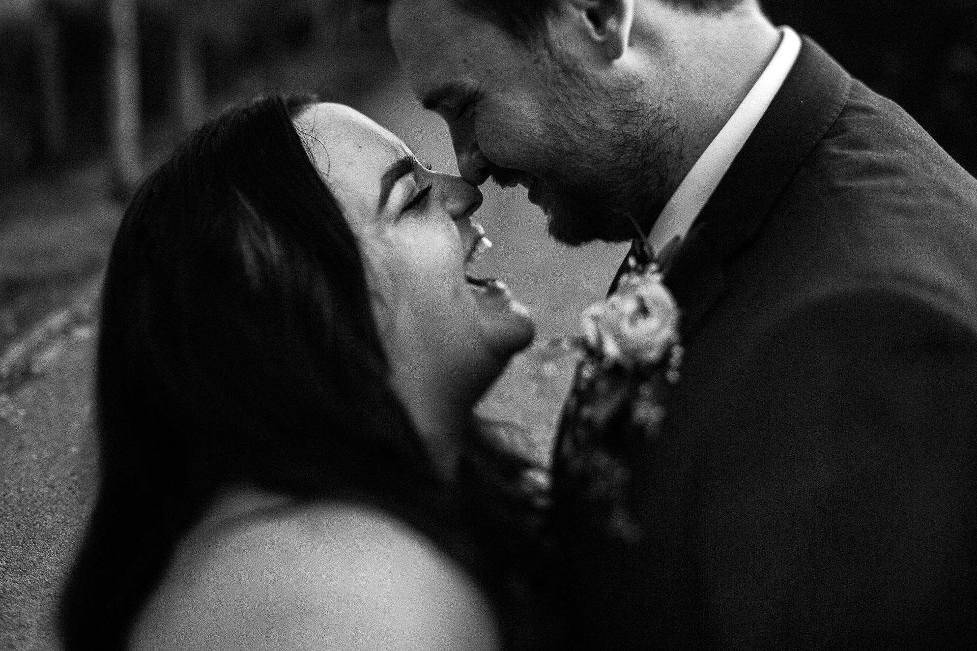 Great Hall at Mains Wedding Photography - S&S - couple laughing, close up in black and white