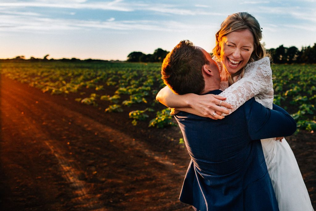 Orrell Hill woods Liverpool Wedding Photography - A&C - bride and groom hugging in a field