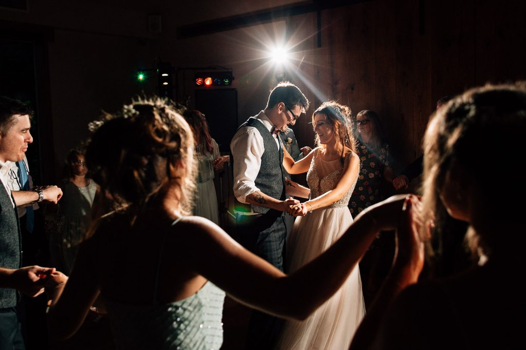 Hyde Bank Farm Wedding Photography - K&P - couple first dance surrounded by friends