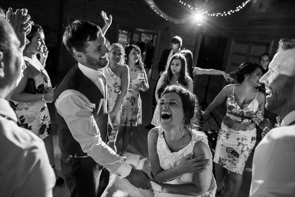 Styal Lodge Wedding Photography - J&D - black and white dancing shot