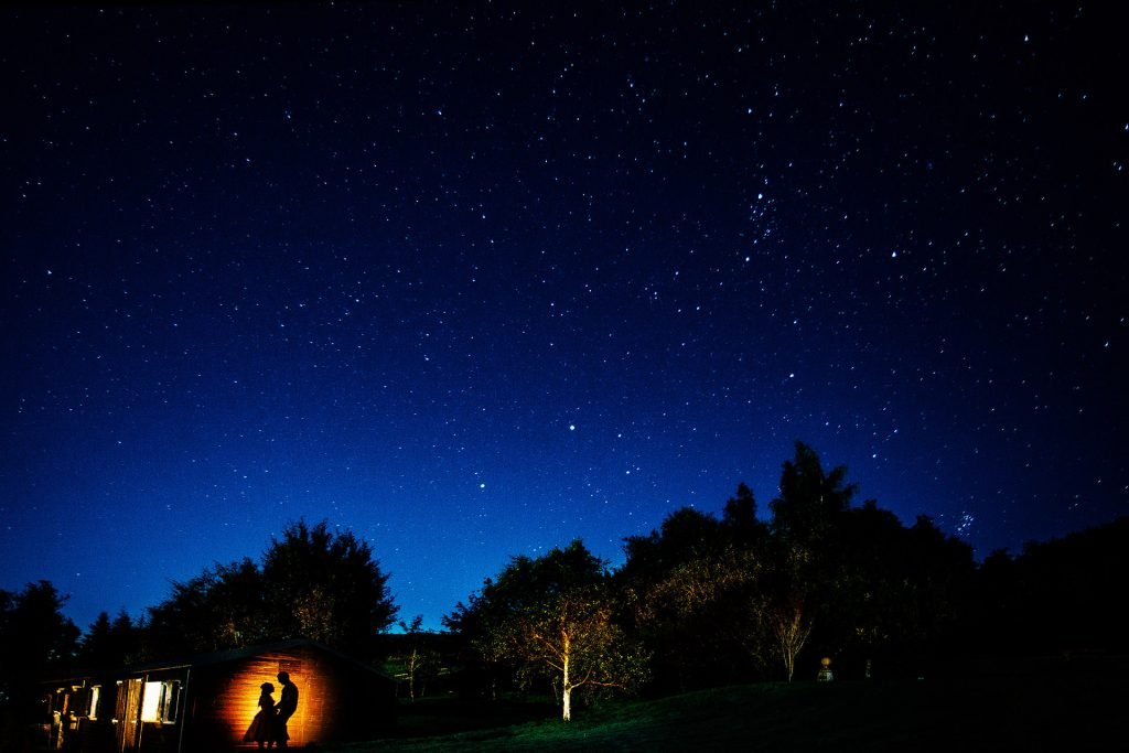 New House Farm Wedding Photography - N&P - Starry night lit shot with silhouette couple