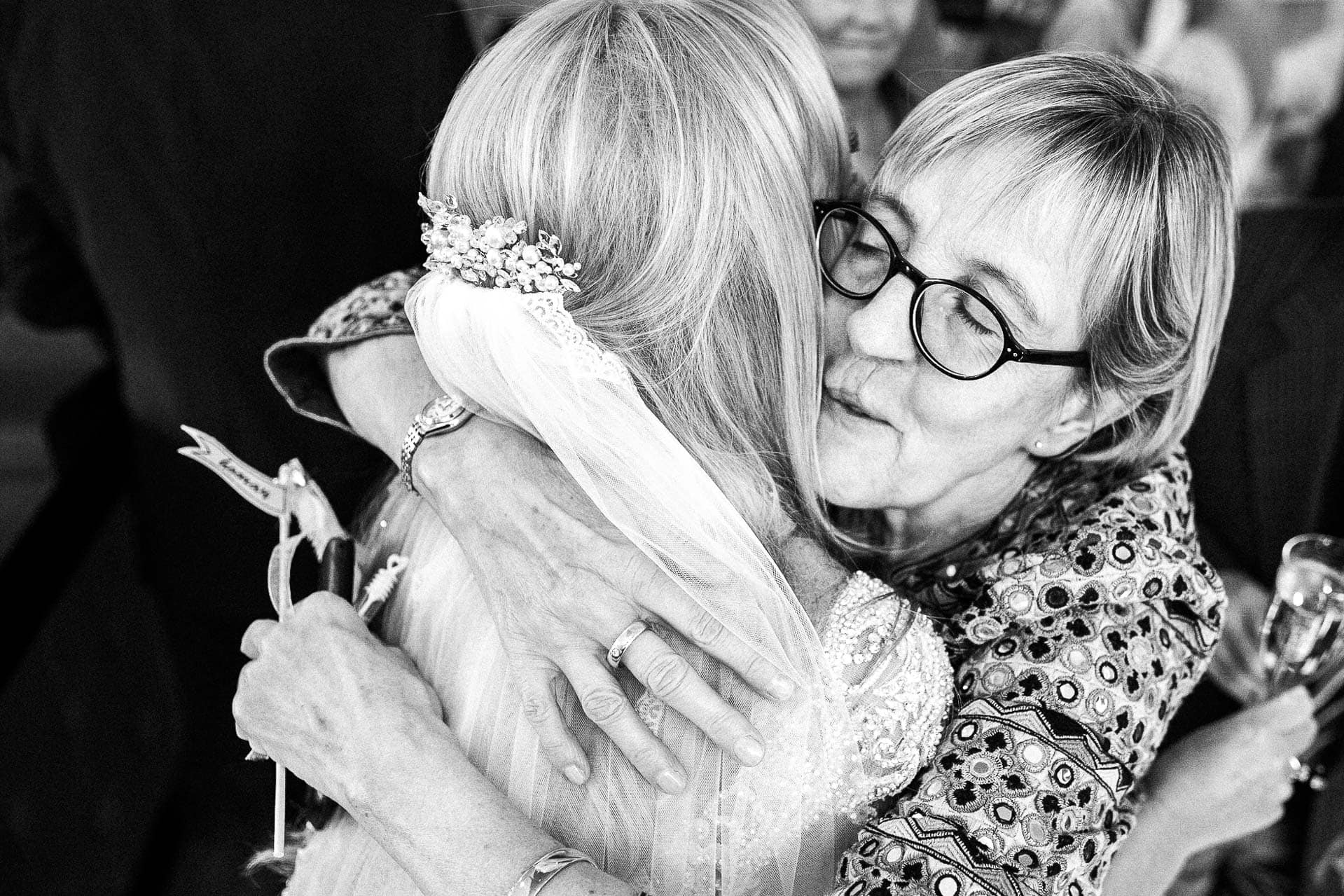 Oddfellows on the Park Monochrome Wedding Photography - VA - hugging after the wedding ceremony