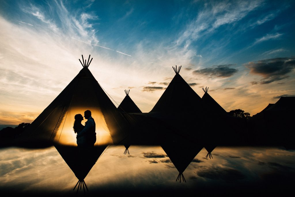 Festival Tipi wedding photography - C&T - silhouette portrait of couple with tipi - magmod