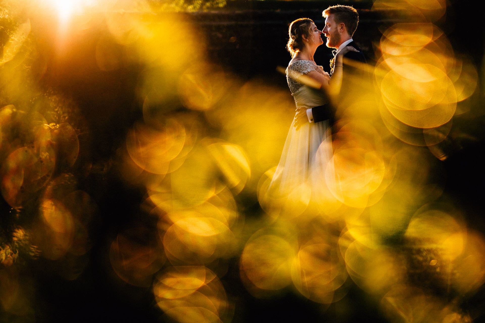 Abbey House Relaxed Lake District Wedding Photography - JD - bride and groom portrait at sunset with leaves