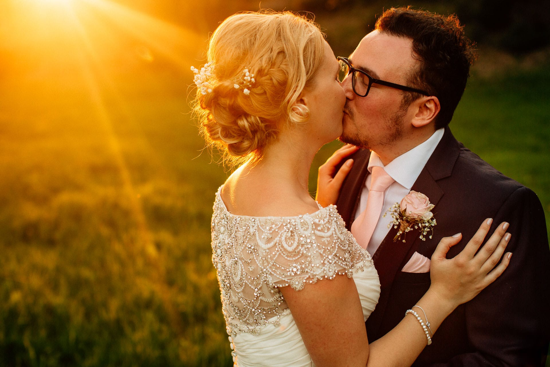 The Wild Boar Wedding Photography - EM - couple kissing in gorgeous golden light